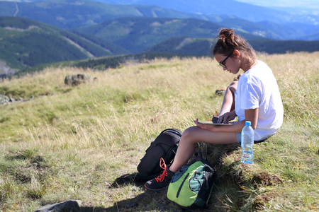 Rest during a mountain hike. Stock Photo