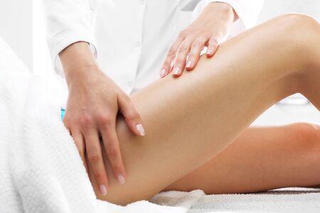 Cellulite, massage thigh. Masseuse massaging thigh