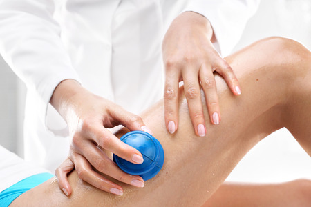 massaged: Lymphatic drainage. Beautician massaged women can rubber bubbles massage. Stock Photo