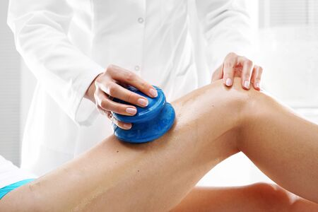 massaged: Manual lymphatic drainage. Beautician massaged women can rubber bubbles massage.