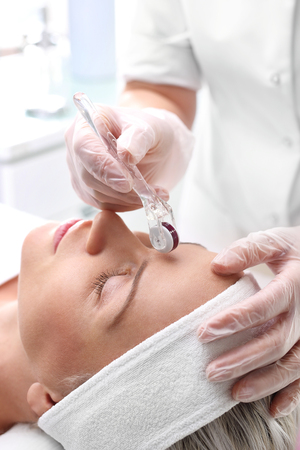 beautification: Microneedle Roller mesotherapy in the wellness clinic.