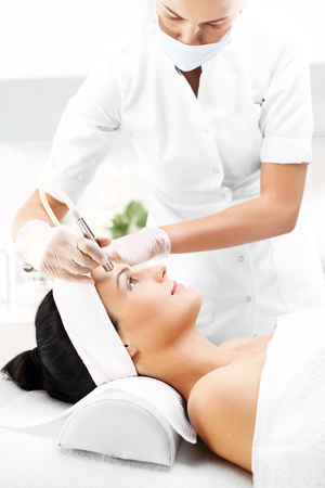 Diamond microdermabrasion. Relaxed woman during a microdermabrasion treatment in beauty salon