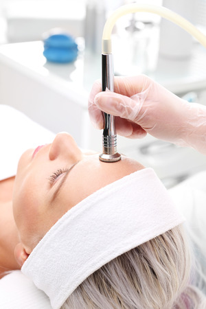 Microdermabrasion. Relaxed woman during a microdermabrasion treatment in beauty salon