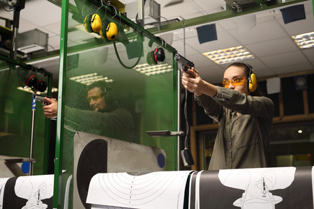 Learning to shoot a gun.