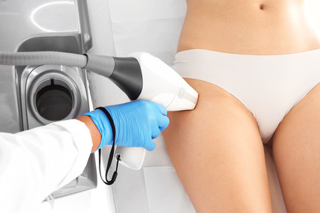 Laser therapy. Woman on laser hair removal treatments thighs and bikini area