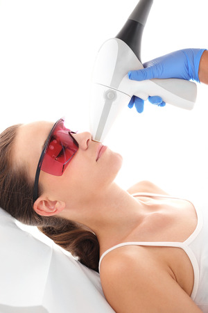 Dermatology, Photorejuvenation. Cosmetic clinic, a woman during laser hair removal facial