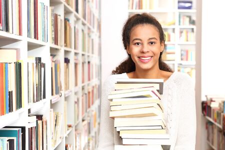 bookshop: girl in the bookstore chooses the book Stock Photo