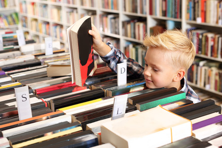 selects: The boy in the school library.