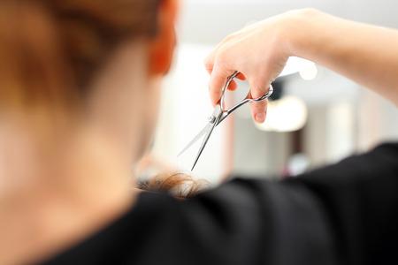 Haircut.Hairdresser. Barber haircut woman in a hair salon