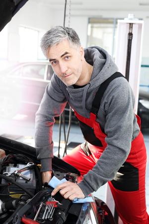 Replacing halogen. Car mechanic exchanges halogen bulb in car