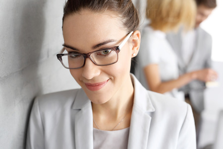 collaborator: Business woman .beautiful young buisinesswoman smile to colleagues. Stock Photo