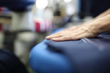 presser: Presser in sewing clothes pressed.