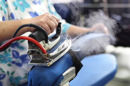 Steam iron: Ironing. Clothing industry. Ironing steam.