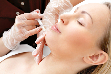 injected: Injections of facial skin. Cosmetic been injected the womans face, the treatment of aesthetic medicine