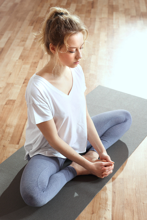 Meditation to calm the mind. Meditating woman is practicing yoga.