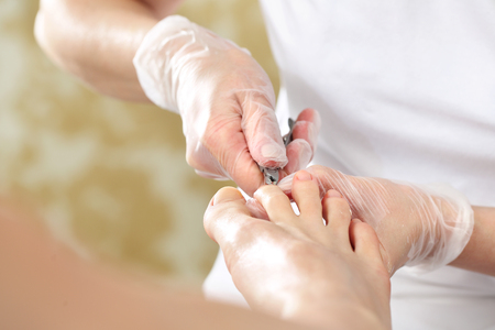 Professional pedicure in the beauty salon. Stock Photo