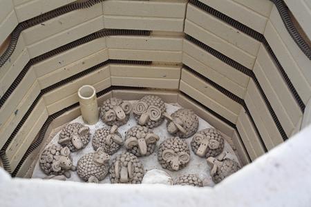 Clay ceramic lamb fired in a ceramic furnace