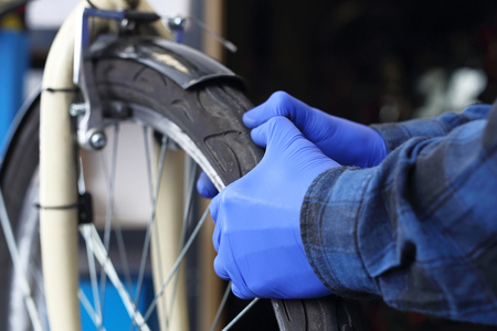 spokes: Centering the wheels. The bike mechanic in the service repairs the wheel in the bike.