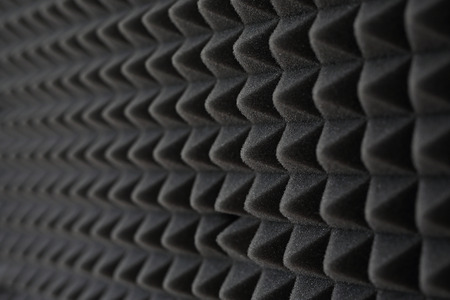 Soundproofing foam. Dark gray foam silencer