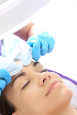 Manual facial cleansing. Cleansing facial skin, blackheads squeezed beautician. Stock Photo