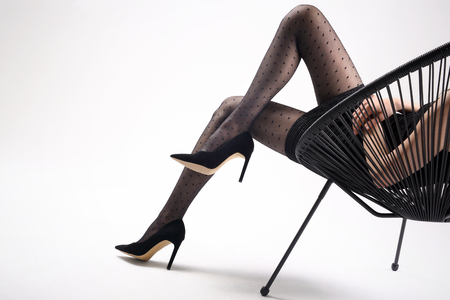 Shapely female legs in pantyhose and high heels
