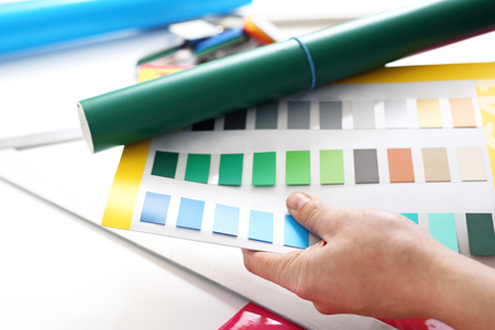 Color sampler. The designer chooses the color of the foil Stock Photo