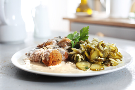 Homemade meatballs. Meatballs in a cream sauce with buckwheat and a cucumber salad.