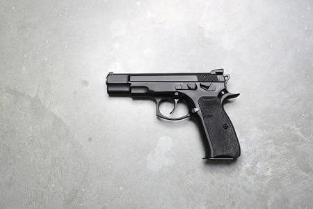 Gun on a gray background.