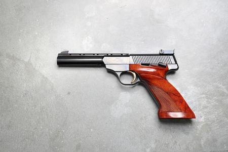 Gun. Gun on a gray background.