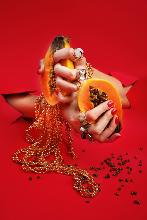 Stylish fashionable nails. The woman is holding a colorful juicy fruit in her hands