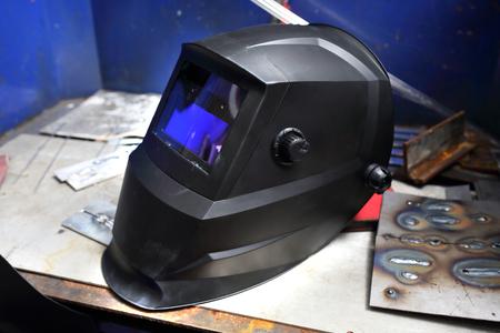 Welders mask. Welders helmet in a workshop, protection against radiation.
