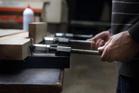 Carpenters workshop. Gluing boards.