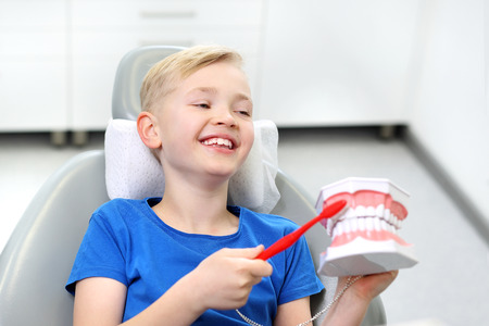 Dentistry, a joyful child in a dental chair