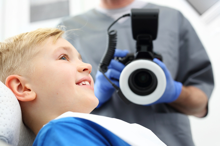 Child at the dentist. A child in a dental chair during a dental treatment Stock Photo