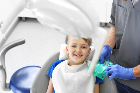 Child at the dentist. A child in a dental chair during a dental treatment Stockfoto