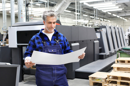 Offset printing. A printer with a printout sheet.