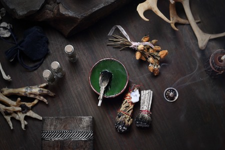 Fairy. Herbal incense and mysterious accessories on the table. Imagens