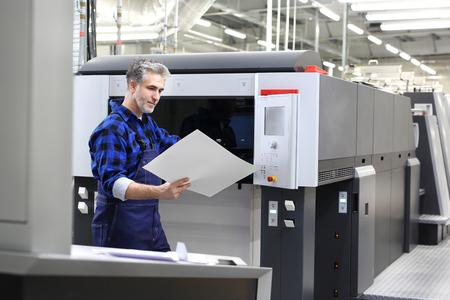Offset printing. A printer with a printout sheet.