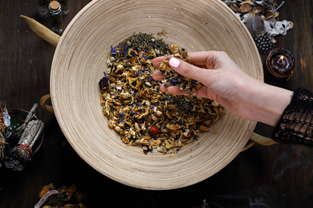 Herbalism, a woman prepares a healing mix of herbs. 스톡 콘텐츠