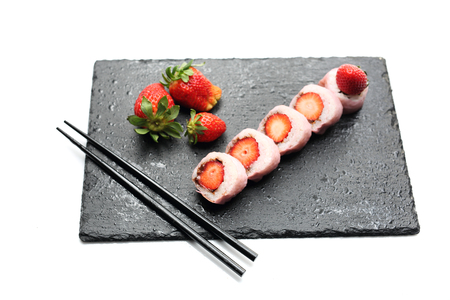 Tasty sweet sushi, fruit dessert. Horizontal composition