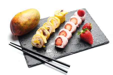 Tasty sweet sushi, fruit dessert. Horizontal composition
