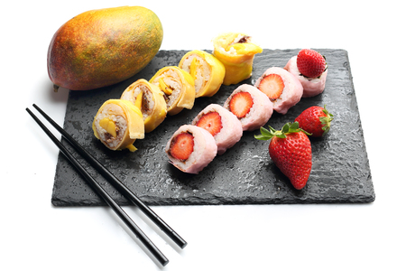 Fruit sushi, sushi roll with banana, sushi with strawberry and mango sushi
