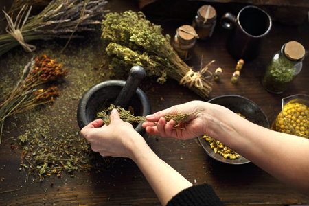 Hands with Alternative medicine, natural herbal methods of treatment