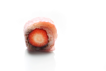 Fruit sushi, a sushi roll with strawberry and chocolate. Reklamní fotografie