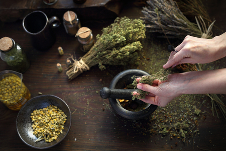 Homeopathy and herbal medicine. The woman prepares natural herbal medicines.
