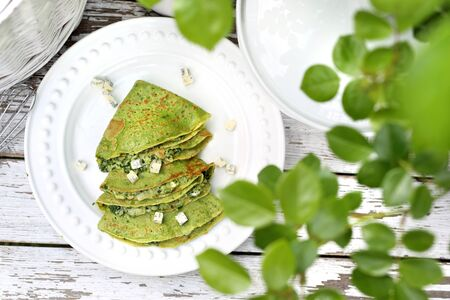 Green pancakes with spinach and blue cheese