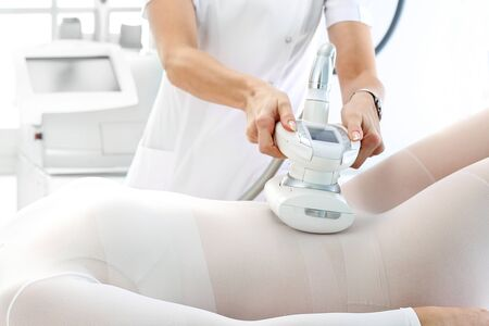 Woman at a cosmetics clinic on body care treatment.