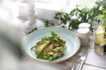 The dish served in the restaurant risotto with asparagus. Proposition of serving the dish.