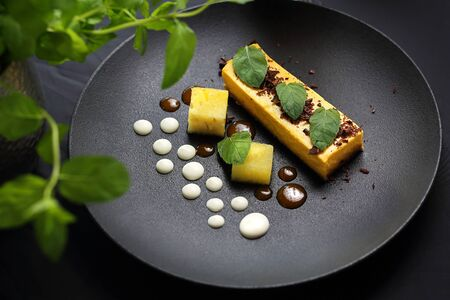 Dessert. A portion of a tasty cake on an elegant black plate. A proposal to serve a dish
