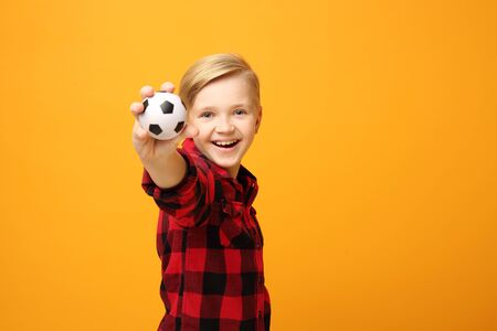 Football, Smiling child with ball.